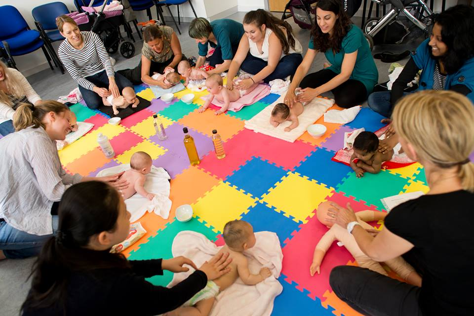 Photo of a parent group - Baby massage taking place at Cardiff Flying Start